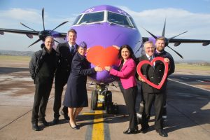 Flybe CEO Christine Ourmieres-Widener and Flybe staff give special send off to Flybe's Valentine's Day aircraft at Exeter airport